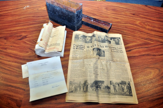 The three items that were found in the time capsule – a Maui News, a letter from the contractor, and blueprints of the post office.