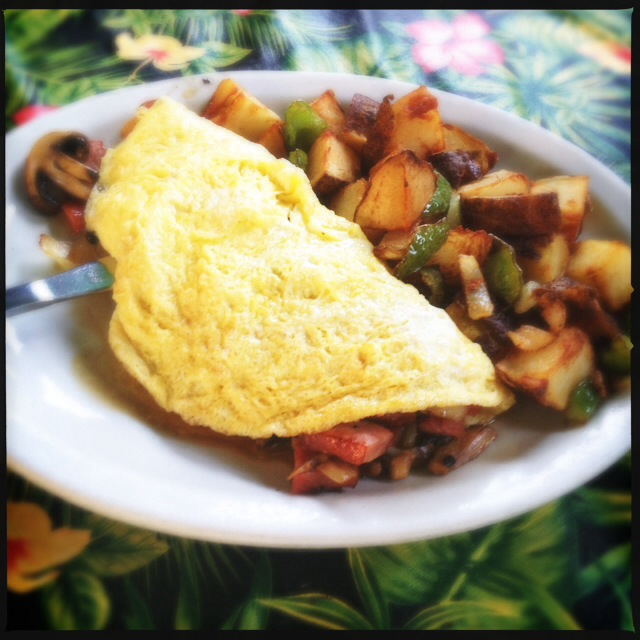 The Omelet arrived with some slightly undercooked home fries. Photo by Vanessa Wolf