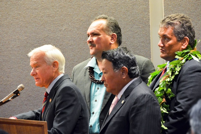 Oahu Mayor Kirk Caldwell speaks as Mayors Bernard Carvalho (Kauai), Alan Arakawa and Billy Kenoi (Hawaii) look on during a joint session of the Senate Ways and Means Committee and the House Finance Committee on Oahu. (1.15.14) Photo courtesy County of Maui.