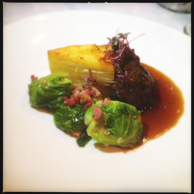 Braised veal cheeks and pancetta Brussels sprouts from a previous Makena Beach event. Photo by Vanessa Wolf