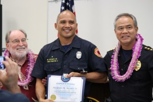 Governor Neil Abercrombie (left), Firefighter II Modesto Jacinto Jr. (middle), and Maui Police Chief Gary Yabuta (right). Photo by Wendy Osher.
