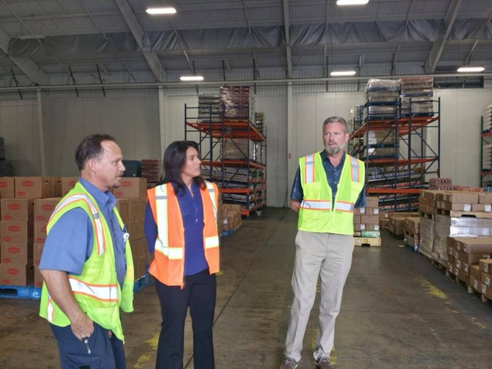 Congresswoman Tulsi Gabbard tours the Pepsi Beverages Company facility on Maui and learns how it is providing jobs for local residents. 10/30/14, courtesy photo.