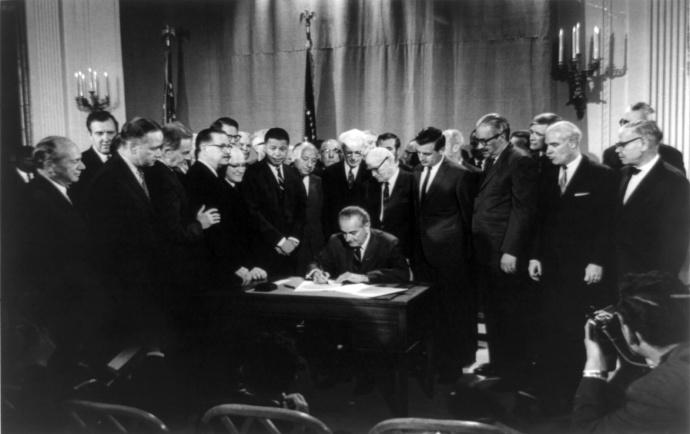 President Lyndon Johnson signing fair housing bill. Photo credit googleimages.