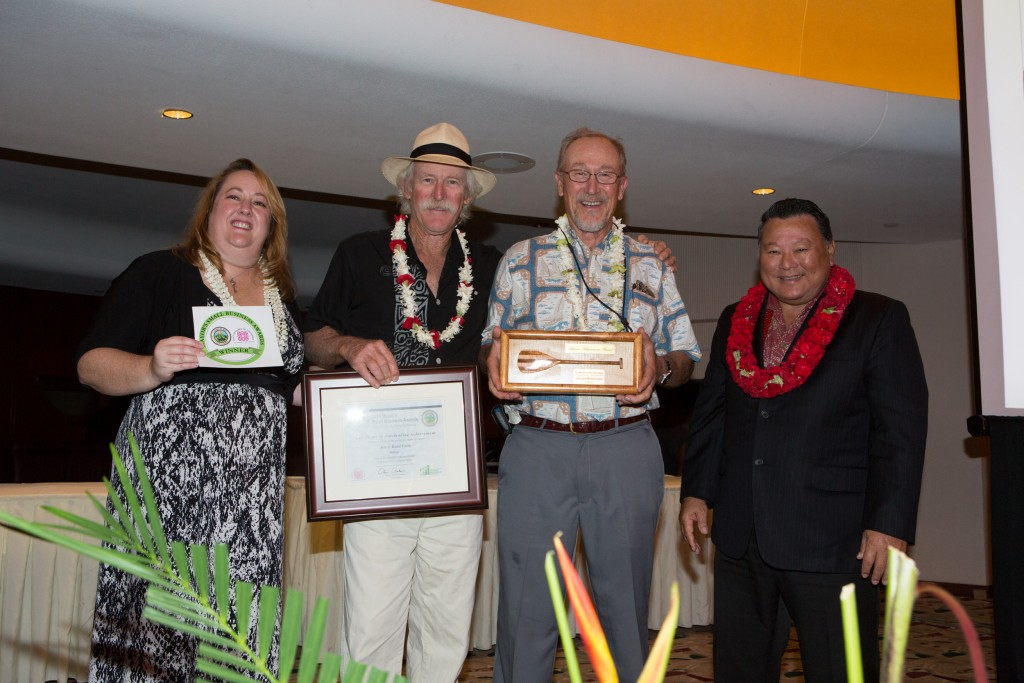 Mayor Arakawa and Pamela Tumpap pose with winners of the 2014 Lifetime Achievement Award, Jim (right) and Rand Coon. File photo credit: County of Maui.