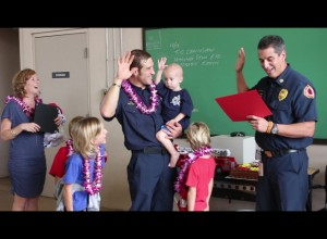 Trucker taking the oath of office as an honorary firefighter. Photo by Wendy Osher. Dec. 14, 2015.