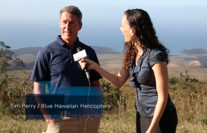 Blue Hawaiian Helicopters pilot Tim Perry speaks to Malika Dudley