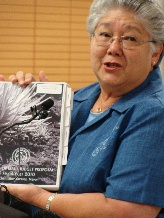 Maui Mayor Charmaine Tavares Displays a copy of the 2010-2011 Budget.  File image by Wendy Osher.