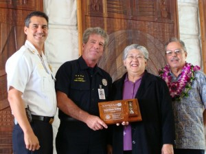 "Photo from left to right: Maui Fire Chief Jeffrey Murray, Firefighter I Lawrence ""Larry"" Crilley, Maui Mayor Charmaine Tavares, Maui Fire Commission Chair Butch Soares"