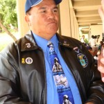 Councilman Bill Kauakea Medeiros delivers a message to family members of the fallen soldiers.