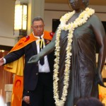 A fresh plumeria lei is one of dozens that were strung for the occasion in honor of the Queen.