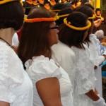 """Members of Hale O Na Ali'i (in the foreground) observe the women of the 'Ahahui Ka'ahumanu (background) as they sing """"Lei Ka'ahumanu"""""""