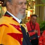 Members of the Royal Order of Kamehameha honor the Queen alongside members of the 'Ahahui Ka'ahumanu.