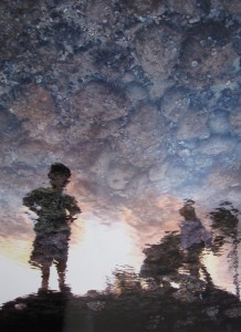First Place: Ghialana Borges, Kahuku High School, 12th grade  Title: Reflections (Silhouette of children near water)  Medium: Photography