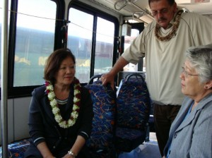 Congresswoman Hirono, Mayor Tavares, and County Council member Mike Victorino discussed the rural bus funds and the benefits the service will provide to the island.  Photo by Wendy OSHER © 2009
