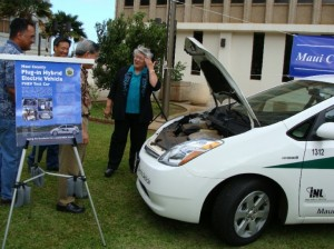 Mayor Tavares looks under the hood of the County's new plug-in hybrid Toyota Prius.
