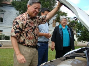 County Energy Commissioner Victor Reyes shows Mayor Tavares her new wheels.  Tavares made renewable energy one of her top issues and the test program is in line with her goals for sustainability.