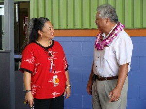 Aloha Air Cargo employee Mary Lu'uwai greets Lana'i Councilman Sol Kahoohalahala, one of the many dignitaries who attended the cargo facility blessing. Photo by Wendy OSHER.