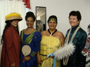 (from left to right: Pacific Radio Group News Director, Wendy Osher; Leina'ala Kuloloio Vedder, Ivy Jean Sanchez, and Edwina Wilson Snyder model holoku in the Princess Ka'iulani Fashion Show and Luncheon)