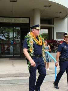 Cheif Tom Phillips (in foreground) walks alongside his Deputy and successor as he is honored during his final day of work before retirement. Photo by Wendy OSHER.