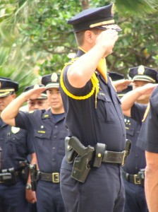 Members of the Maui Police Department stand at attention as they salute Maui's long time chief Tom Phillips on his last full day at work.  Photo by Wendy OSHER.