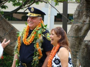 Chief Phillips accompanied by his wife Brenda at a photo unveiling and flag folding ceremony held in his honor.  Photo by Wendy OSHER.