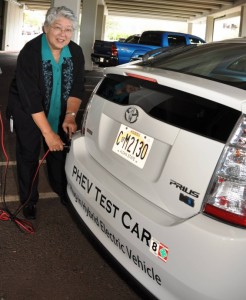 Maui Mayor Charmaine Tavares plugs in the county's Hybrid electric-car collecting data on its usage and performance.  Photo courtesy, County of Maui.