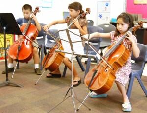 L-R: Jake Thomas (7), Katherine Swor (8) and Jenna Quiocho (8) refine their cello skills at the Maui Summer Music Festival 2009. Photo courtesy Malia Quiocho.