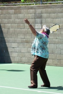 Mayor Charmaine Tavares takes a serve on the newly opened courts. Photo courtesy, County of Maui.