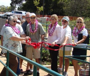 Ribbon untying (L-R): Mayor Charmaine Tavares; Steve Sutrov, Kula Tennis Club (white cap); Fiona van Ammers, design consultant; John Stevens, tennis enthusiast (visor); Parks Director Tamara Horcajo. Photo courtesy, County of Maui.