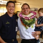 "New battalion chief James ""Kimo"" Kino is congratulated by his son, Maui Fire Fighter II Kaulana Kino, and grandson Hamilton Kino, age 2.  Photo by Wendy Osher."