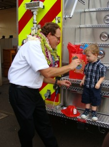"James ""Kimo"" Kino shares a moment with his grandson Hamilton at the pinning ceremony.  Photo by Wendy Osher."