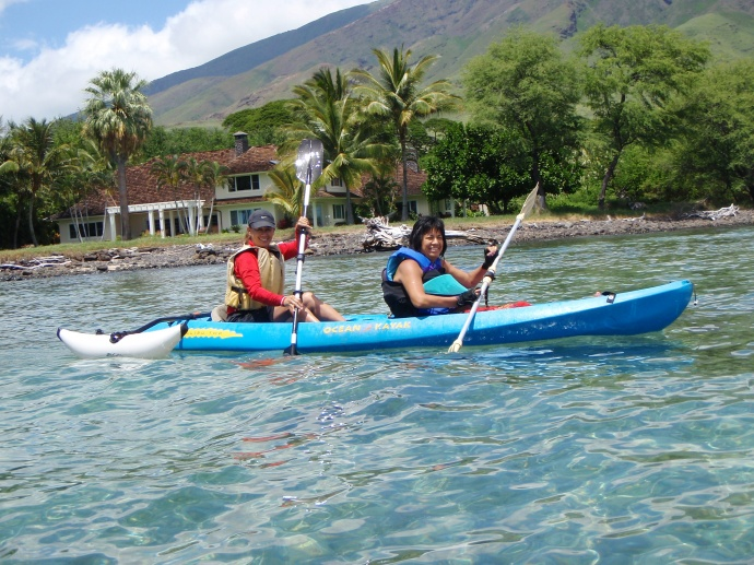 """Photo Courtesy: County of Maui. (L-R) Fran Yamamoto, a Recreation Technician with the County Dept. of Parks & Recreation, paddles with Karen """"Alohilani"""" Hue-Sing Ledesma in the adaptive kayaking session held in August, 2009. Karen is a member of the Mayor's Commission on Persons with Disabilities."""