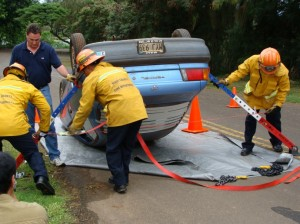 File Photo by Wendy Osher: Maui Firefighters test tools and equipment for extracting trapped motorists during the November Fire Chief's Convention in Kapalua, Maui.