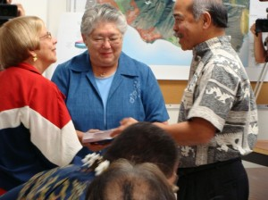 Finance Director Fred Pablo (right) joins Maui Mayor Charmaine Tavares (middle) in unveiling the FY 2010-2011 Budget in March with Councilmember Gladys Baisa (left) looking on.