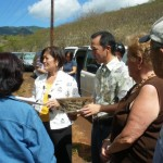 Congresswoman Mazie K. Hirono is briefed by Brian Niiya of the Japanese Cultural Center of Hawaii at the Honouliuli Internment Camp site on Oahu. August 28, 2009.  Courtesy file photo.