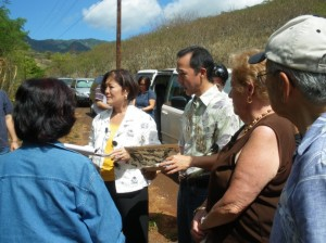 Congresswoman Mazie K. Hirono is briefed by Brian Niiya of the Japanese Cultural Center of Hawaii at the Honouliuli Internment Camp site on Oahu. August 28, 2009.  Courtesy photo.