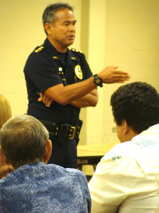 Maui Police Chief Gary Yabuta fields questions from Lahaina residents at a Town Hall meeting initiated last year. Photo by Wendy Osher.