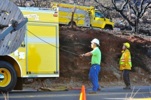 Hawaiian TelCom crews worked to restore phone service after the fire above Maalaea damaged fiber used to serve the West Maui area. Photo Courtesy County of Maui.