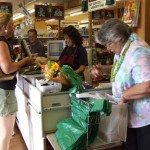 Maui Mayor Charmaine Tavares is pictured bagging groceries during an event at Pukalani Superette, highlighting reef protection and encouraging decreased use of plastic bags. FILE PHOTO: County of Maui, August 2008