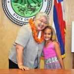 Mayor Charmaine Tavares gets a hug from PALS participant Jordynn Brown, 7, who gave the Mayor a lei to celebrate the 20th anniversary of PALS.
