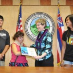 "Managing Director Sheri Morrison accepts a certificate of recognition on behalf of Mayor Charmaine Tavares from Baldwin High School Best Buddies (L-R) Buddy Director Shaun Labang, ""Buddy"" Rachel Barrett, and (far right) Best Buddies Chapter President Heather Paranada. Photo courtesy County of Maui."