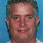 "PERRY JAY GRIGGS is 49 years old, 5'10"" tall, 180 pounds, with grey hair and blue eyes. He is known to have expensive tastes in sports cars, high-end clothing, cigars and golf.  Photo courtesy FBI."