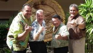 Kauai Mayor Bernard Carvalho, Jr., Honolulu Mayor Peter Carlisle, Maui Mayor-Elect Alan Arakawa, and Big Island Mayor Billy Kenoi flash the shaka during a recent meeting on Kauai. Courtesy Photo.