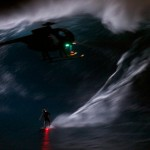 Mark Visser surfing Jaws at night.  Photo courtesy Fortrus Sports. Click image to view video.