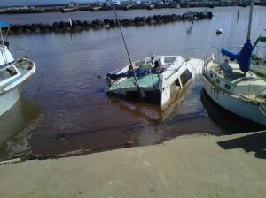 One of several boats that sank at Māʻalaea Harbor following one of the tsunami surges, resulting from the March 11, 2011 Japan earthquake. File photo by Sonia Isotov.