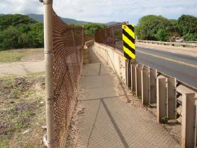 Existing pedestrian walkway at the Iao Stream Bridge.  Photo courtesy DOT, Highways & Wilson Okamoto Corp.