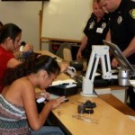 Maui Police officers Chris Schmitt and Nick Krau assisted students in a two day career shadowing workshop at UH Maui College.  The career shadowing workshop was one in a series offered to high school students on Maui who want to explore possibilities beyond high school. One of the degrees offered through the UHMC distance learning program is Justice Administration. Courtesy file photo.