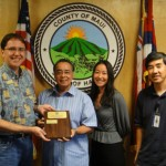 Managing Director Keith Regan presents a perpetual plaque to County Council Chair Danny Mateo.  Also pictured are Susan Clements, Executive Asst. to Councilmember Don Couch and Bruce Hashimoto of the Office of Council Services.