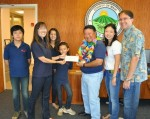 Carden Academy Principal Nina Sato and students present a donation to the Japanese Cultural Society of Maui for The Aloha Initiative.  Receiving the donation on behalf of the organization is Mayor Alan Arakawa, honorary chair of The Aloha Initiative, and Lynn Araki-Regan & Keith Regan, co-founders of The Aloha Initiative.