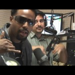 Shawn Wayans shoots the shaka with Da Jam 98.3 FM's Mackie Mac in the background. Photo by Wendy Osher.